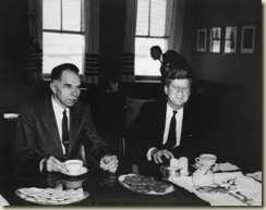 Seaborg and Kennedy enjoy some cookies.
