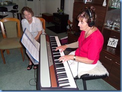 Delyse Whorwood trying out the Korg SP250 digital piano with Jean Watt watching on attentively