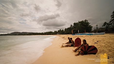 Skimboarders Taking a Break at Pagudpud's Saud Beach