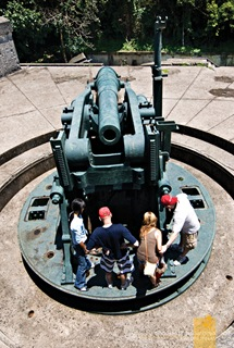 Inspecting One of the Disappearing Guns at Corregidor