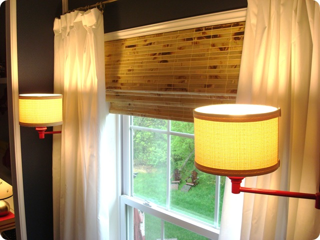Swing arm sconces by window