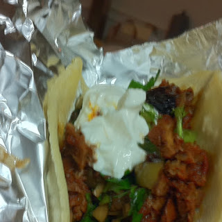 Chipotle Braised Lamb Tacos with Olives and Balsamic Soaked Raisins