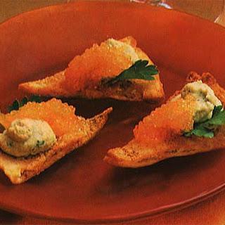 Smoked Caviar and Hummus on Pita Toasts.
