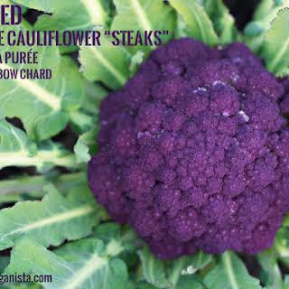 "Seared Purple Cauliflower ""Steaks"" with pea purée and rainbow chard."