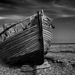 Dungeness beach. by Dave Byford - Black & White Landscapes ( england, kent, beach, dungeness, boat, abandoned,  )