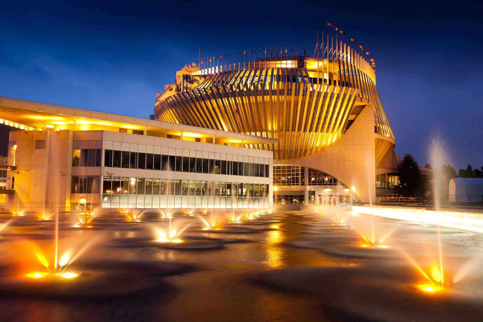 The Casino de Montreal glimmers in the evening.