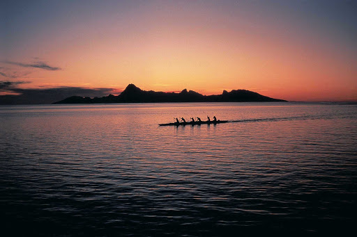 Outrigger-Canoe-Sunset - The sight of an outrigger canoe at sunset transports you back in time.