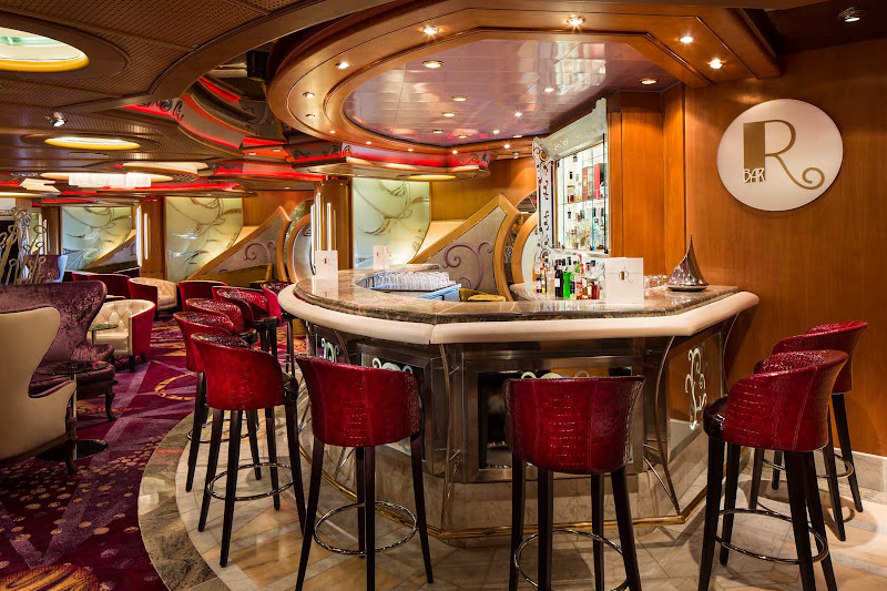 Relax and enjoy a pre-dinner drink at the R Bar aboard Navigator of the Seas.