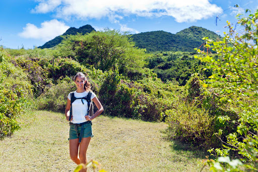 Hiking between the two smaller twin mountains of Signal Hill and Little Mountain on the island of St. Eustatius.