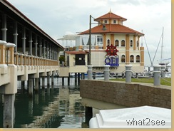 Tanjung City Mirina and Church Street Pier with QEII at background