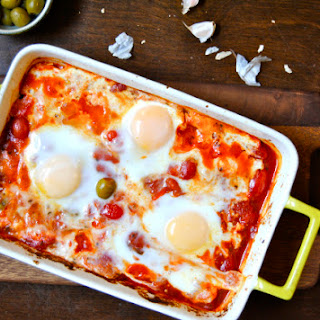 Baked Feta with Olives, Tomatoes and Eggs.