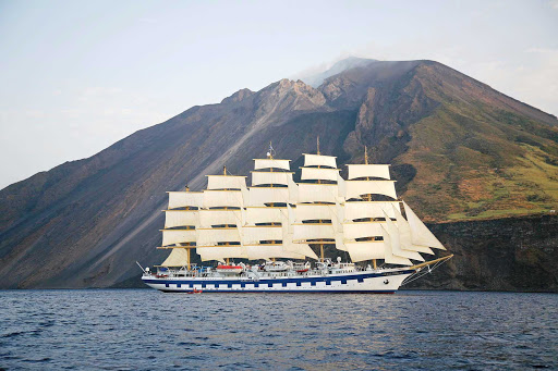 Royal-Clipper-at-Stromboli-Italy - Get breathtaking views of Stromboli, Italy's large volcano, as Royal Clipper sails the Tyrrhenian Sea, part of the Mediterranean.