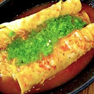 Tacos Dorados Ahogados (Toasted Tacos with Salsa).