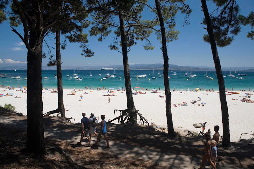 Rodas-Beach-Vigo- Spain - One of the best beaches in the world? That's what several noted publications have called Rodas Beach in Vigo, Spain. The beach is known for its crystal waters, white sandy beaches and natural dunes.