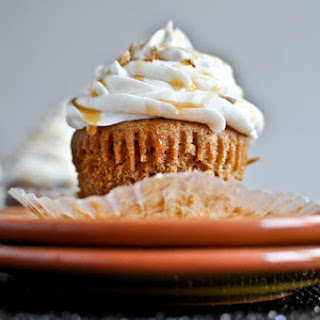 Sweet Potato Pie Cupcakes with Marshmallow Frosting.