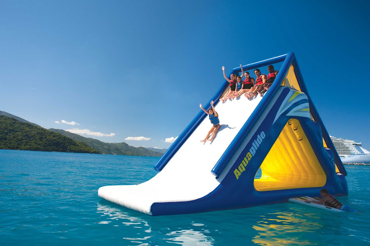 Kids go slip sliding into the warm Caribbean waters of Labadee, Haiti, during an Allure of the Seas cruise.