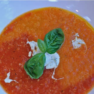 Roasted Carrot & Tomato Soup with a Topping of Basil Infused Creme Fraiche.