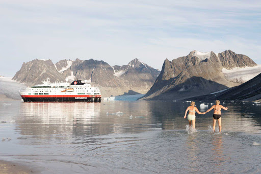Hurtigruten-swimming-in-arctic - Take an afternoon dip in the Arctic Ocean — or just watch human polar bears in action — as you cruise the Svalbard Islands on board Fram, Hurtigruten's flagship.