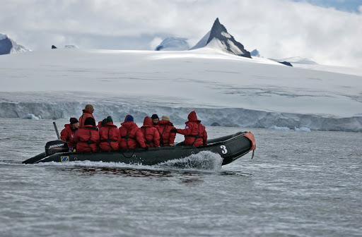 060d2Zodiac - Now comes the fun part, cruising by Zodiac boat past glaciers and icebergs. That rocky point sticking up is called a nunatuk.