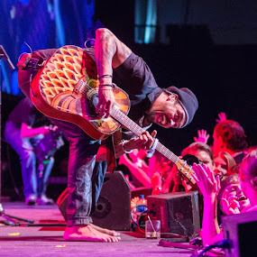 Michael Franti Performing At A Charity Concert by Hans Watson - People Musicians & Entertainers ( nightshine gala, creativity, lighting, art, artistic, purple, mood factory, lights, color, fun,  )
