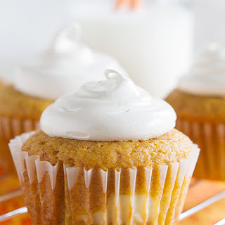 Pumpkin Cheesecake Cupcakes with Brown Sugar Marshmallow Frosting.