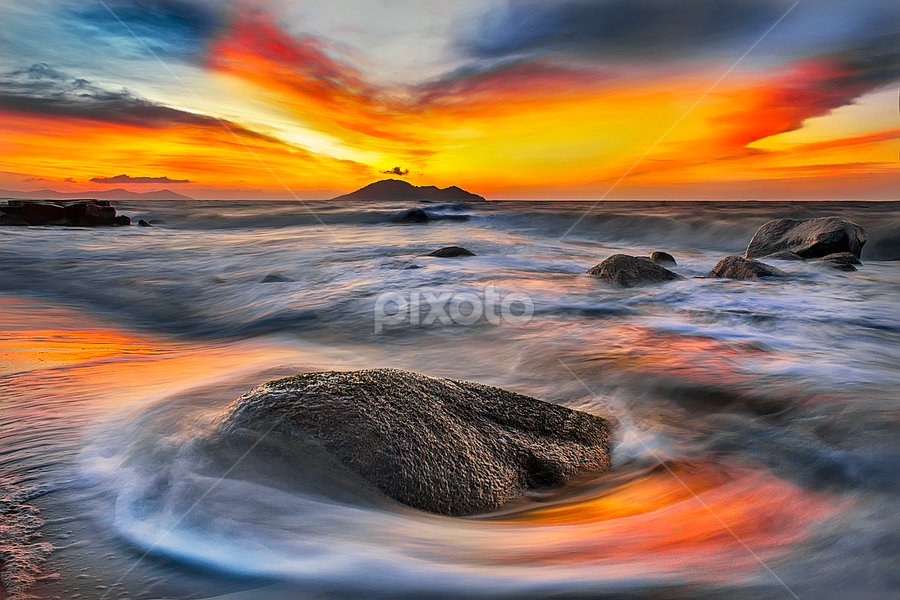 Rock and sunset clouds by Dany Fachry - Landscapes Beaches
