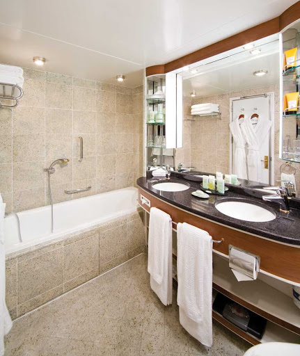 Silversea_Veranda_Suite_bathroom - Press your toes against the fine marble in the Veranda Suite bathroom aboard Silver Shadow, outfitted with a full size bath and separate tub.
