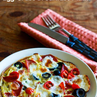 Egg-Crust Breakfast Pizza with Pepperoni, Olives, Mozzarella, and Tomatoes.
