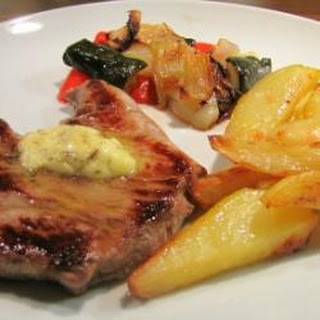 Lamb Steaks With Rosemary Butter And Tray Baked Sunshine Vegetables