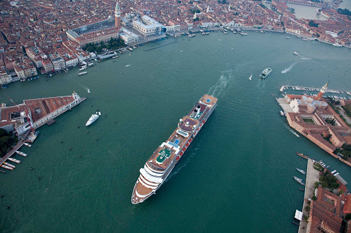 Holland-America-Nieuw-Amsterdam-in-Venice - Aerial shot of Nieuw Amsterdam sailing into Venice. Launched in Venice on July 4, 2010, Nieuw Amsterdam celebrates the cultural traditions of New York (named Nieuw Amsterdam once upon a time) with its interior design and art collection.