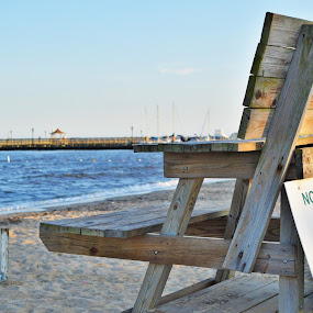 Off Duty by Suzanne Tutak - Landscapes Beaches ( water, lifeguard, sand, chair, no swimming, sunset, summer, marina, beach, dock, Chair, Chairs, Sitting )