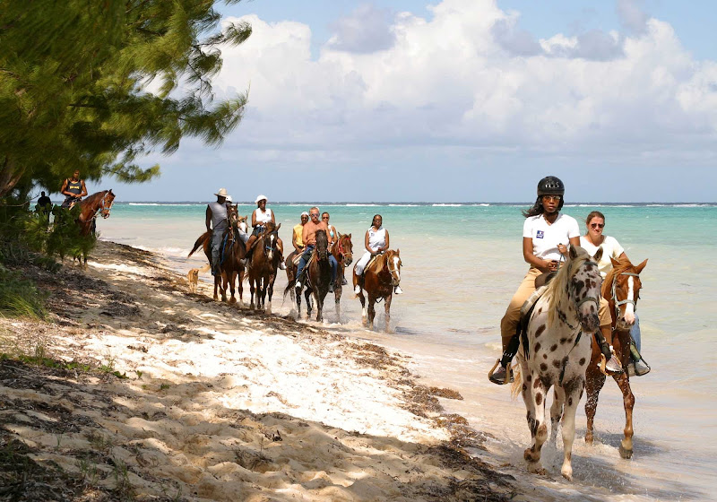 Horseback riding on Barkers Beach on Grand Cayman Island.