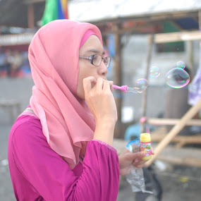 playing bubble by Danang Kusumawardana - People Portraits of Women