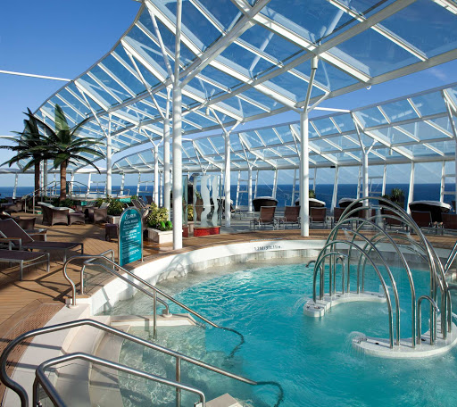 The Solarium on Allure of the Seas offers guests a place to soak up some rays and relax with a drink.