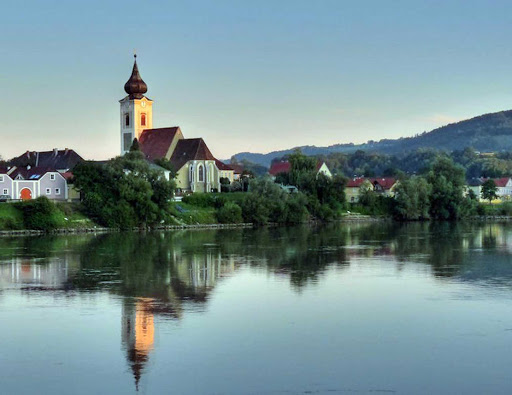 A tranquil scene on the Danube above the town of Melk, Austria.