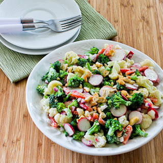Barely Blanched Broccoli and Cauliflower Salad with Red Bell Pepper, Radishes, Red Onion, and Cashews.
