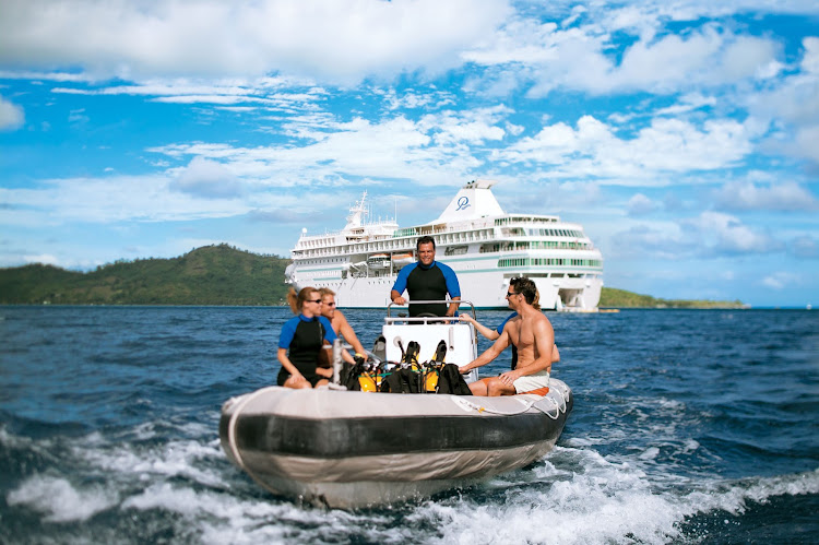 Set out for a scuba adventure from the Paul Gauguin's retractable water sports platform.