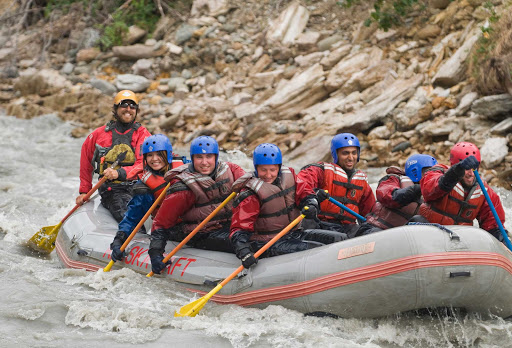 guide-raft-Denali-2 - In smaller rafts, everyone paddles through white-water rapids in Denali National Park, Alaska.