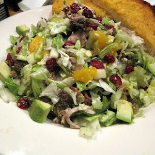 Mixed Green Salad with Oranges, Dried Cranberries and Pecans.