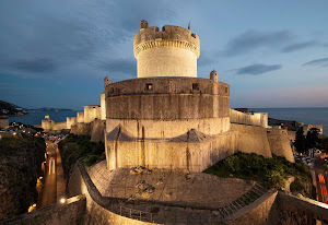 The historic fortified city walls and tower in Dubrovnik, Croatia.