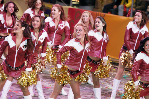 Cheerleaders from the San Francisco 49ers — the Gold Rush — participate in the Chinese New Year Parade in Hong Kong.