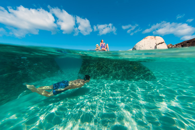 Snorkel, swim or sunbathe at a pristine lagoon in Virgin Gorda, British Virgin Islands.