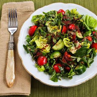Mediterranean Lettuce Salad with Purslane, Mint, Tomatoes, Cucumbers, and Sumac-Lemon Vinaigrette.