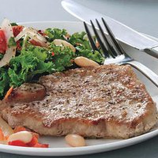 Pork Chops with Stewed Cannellini Beans.