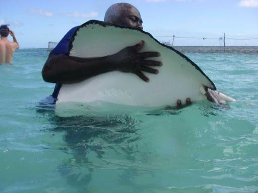 stingray-Antigua.jpg - Hugging a stingray in Antigua.