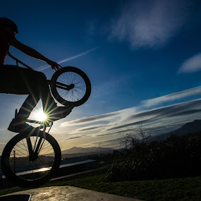The Launch by Gary Piazza - Sports & Fitness Cycling ( bikes, sunset, bmx, , Bicycle, Sport, Transportation, Cycle, Bike, ResourceMagazine, Outdoors, Exercise, Two Wheels, silhouette, #GARYFONGDRAMATICLIGHT, #WTFBOBDAVIS )