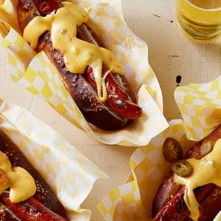 Pretzel Buns with Grilled Dogs and Spicy Cheese Sauce