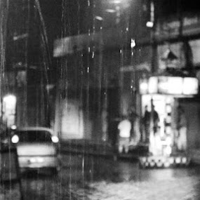 Once Upon A Time In A City by Bhaskar Kalita - Black & White Street & Candid ( rainy day, rainy, black and white, street, rain drops, evening, rain, street photography )