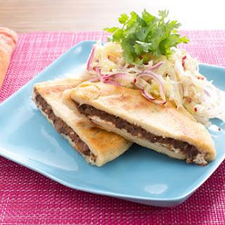 Salvadoran Black Bean & Cheese Pupusas with Cabbage & Radish Curtido.