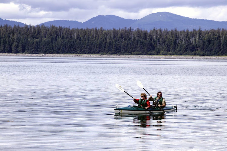 Glide through peaceful waters in a double kayak in Glacier Bay National Park, Alaska.